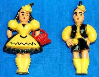 vintage Yellow plastic Dutch boy & girl Pins
