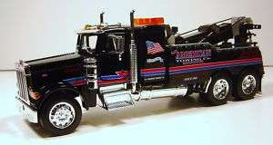 32 PETERBILT TOW TRUCK AMERICAN TOWING DIE CAST BLACK