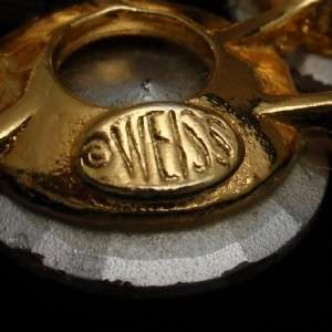 Light vitrail colored rivoli rhinestones set in goldtone metal