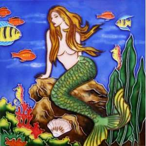 Mermaid Under the Sea with Tropical Fish and Coral Reefs