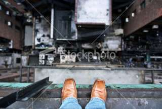 Down From a High Ledge   Suicide Concept Royalty Free Stock Photo